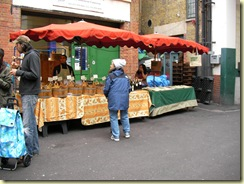 Mom looking at olives and olive oil at Borough Market