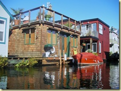 Our old houseboat now with a boat in front